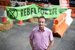 © Licensed to London News Pictures. 30/08/2019. Manchester, UK. CHRIS DAVIES MEP on Deansgate in support of the protest . Extinction Rebellion block roads , in Manchester City Centre , at the start of several days of planned disruption organised by environmental campaigners . Manchester City Council has declared a climate emergency but activists say the council's development plans do not reflect this . Photo credit: Joel Goodman/LNP