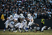 Oakland Raiders strong safety T.J. Carrie (38) sacks Indianapolis Colts quarterback Andrew Luck (12) late in the game at Oakland Coliseum in Oakland, Calif., on December 24, 2016. (Stan Olszewski/Special to S.F. Examiner)