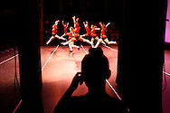 """Carmen Watts, 9, watches her instructors perform """"Pop""""  from backstage at Victoria's School of Dance Spring Recital at the Tampa Bay Performing Arts Center in Tampa. Watts later performed with her older sister Kayla Watts to """"I'll Stand By You"""".  About 275 dancers from ages three and up performed in the annual recital which included ballet, hip-hop and tap."""