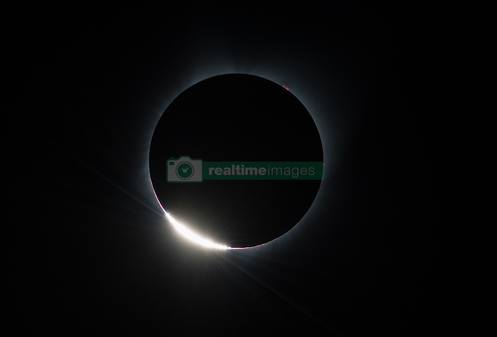 The Diamond Ring  effect is seen as the moon makes its final move over the sun during the total solar eclipse on Monday, August 21, 2017 above Madras, Oregon. A total solar eclipse swept across a narrow portion of the contiguous United States from Lincoln Beach, Oregon to Charleston, South Carolina. A partial solar eclipse was visible across the entire North American continent along with parts of South America, Africa, and Europe.  Photo Credit: (NASA/Aubrey Gemignani)