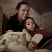 Earlier this fall Austeja moved to Frøya for high school. But on weekends she comes home, and her little sister Anna Karina wants to be around her all the time, even while sleeping.