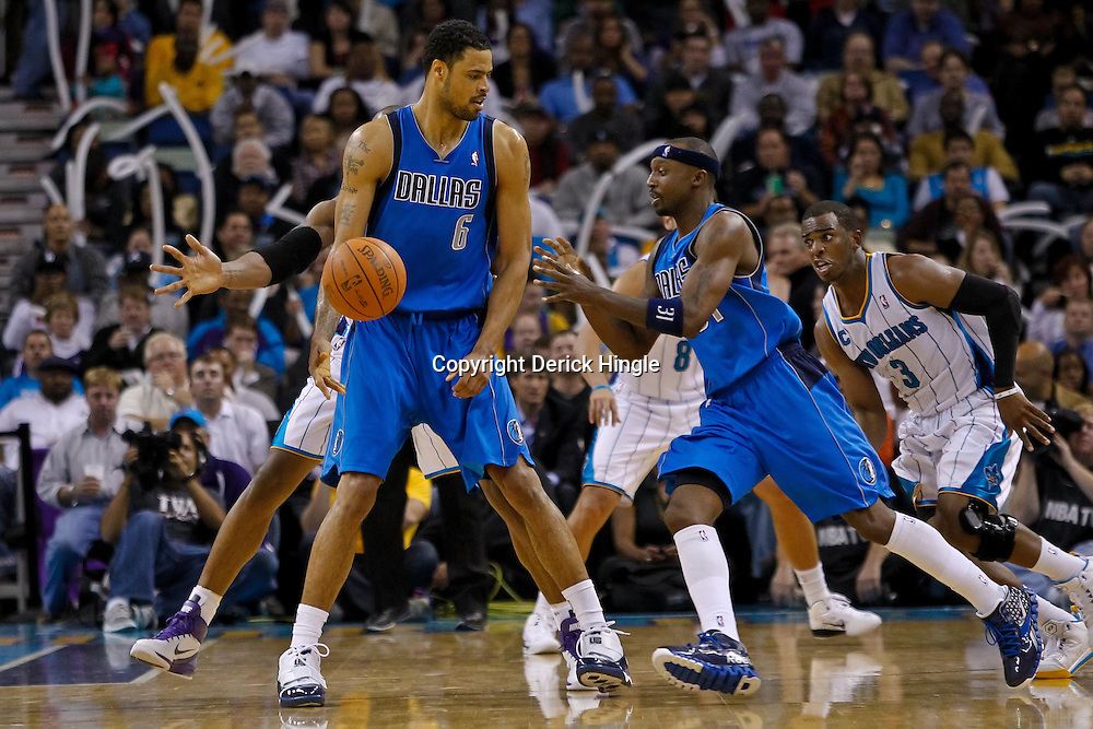 November 17, 2010; New Orleans, LA, USA; Dallas Mavericks center Tyson Chandler (6) passes to shooting guard Jason Terry (31) during the second half against the New Orleans Hornets  at the New Orleans Arena. The Hornets defeated the Mavericks 99-97. Mandatory Credit: Derick E. Hingle