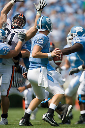 Virginia defensive end Chris Long (91) pressures North Carolina quarterback T.J. Yates (13).  The North Carolina Tar Heels football team faced the Virginia Cavaliers at Kenan Memorial Stadium in Chapel Hill, NC on September 15, 2007.  UVA defeated UNC 22-20.