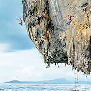 Climber Leaps off a cliff during a deep water solo in Thailand