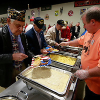 Thomas Wells | BUY AT PHOTOS.DJOURNAL.COM<br /> John Blanchard, left, joins hundreds of veterans during Wednesday's Veterans Day breakfast at the Tupelo Automobile Muesum.