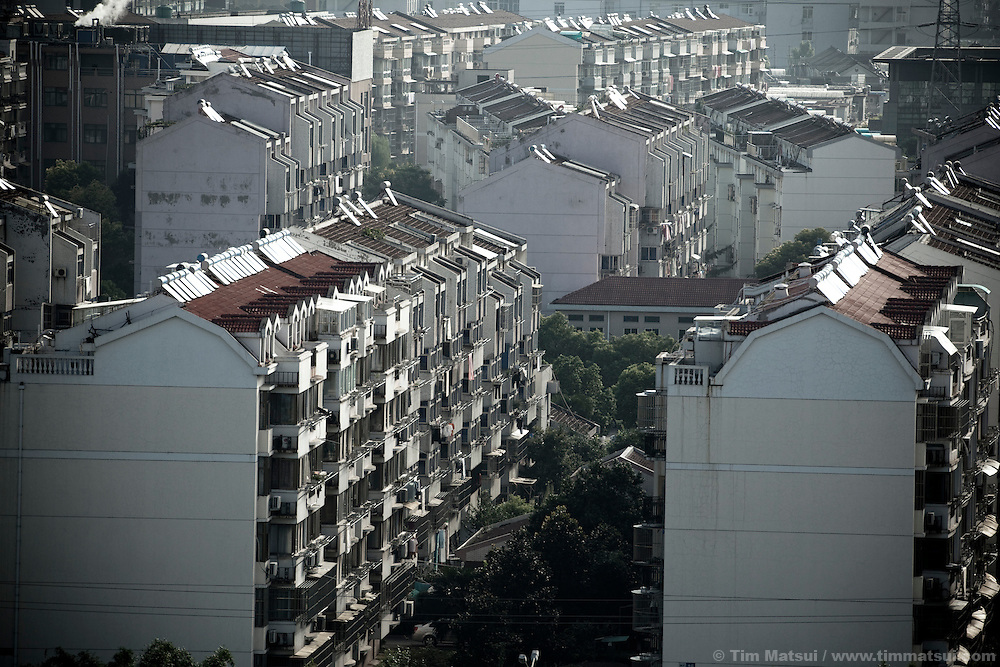 "Apartment blocks in the ""New City,"" part of the expansion of Yangzhou, China, a suburb city of Shanghai and major producer of photovoltaic cells for the renewable energy solar power industry."