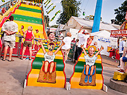 "01 SEPTEMBER 2011 - ST. PAUL, MN:  Teenagers in front of photo cutouts near the Giant Slide at the Minnesota State Fair. The Minnesota State Fair is one of the largest state fairs in the United States. It's called ""the Great Minnesota Get Together"" and includes numerous agricultural exhibits, a vast midway with rides and games, horse shows and rodeos. Nearly two million people a year visit the fair, which is located in St. Paul.   PHOTO BY JACK KURTZ"