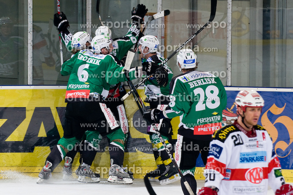 Team HDD Tilia Olimpija celebrate during ice-hockey match between HDD Tilia Olimpija and EC KAC in 32nd Round of EBEL league, on December 30, 2010 at Hala Tivoli, Ljubljana, Slovenia. (Photo By Matic Klansek Velej / Sportida.com)