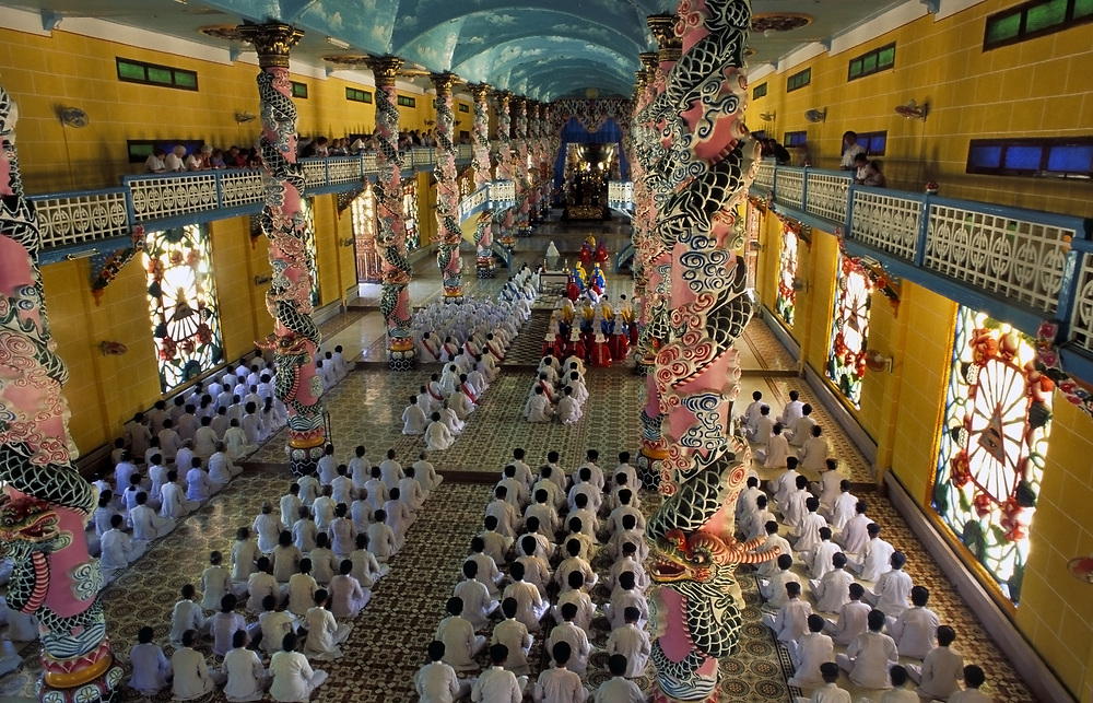 Prayer service at the Cao Dai temple at Tay Ninh, Vietnam