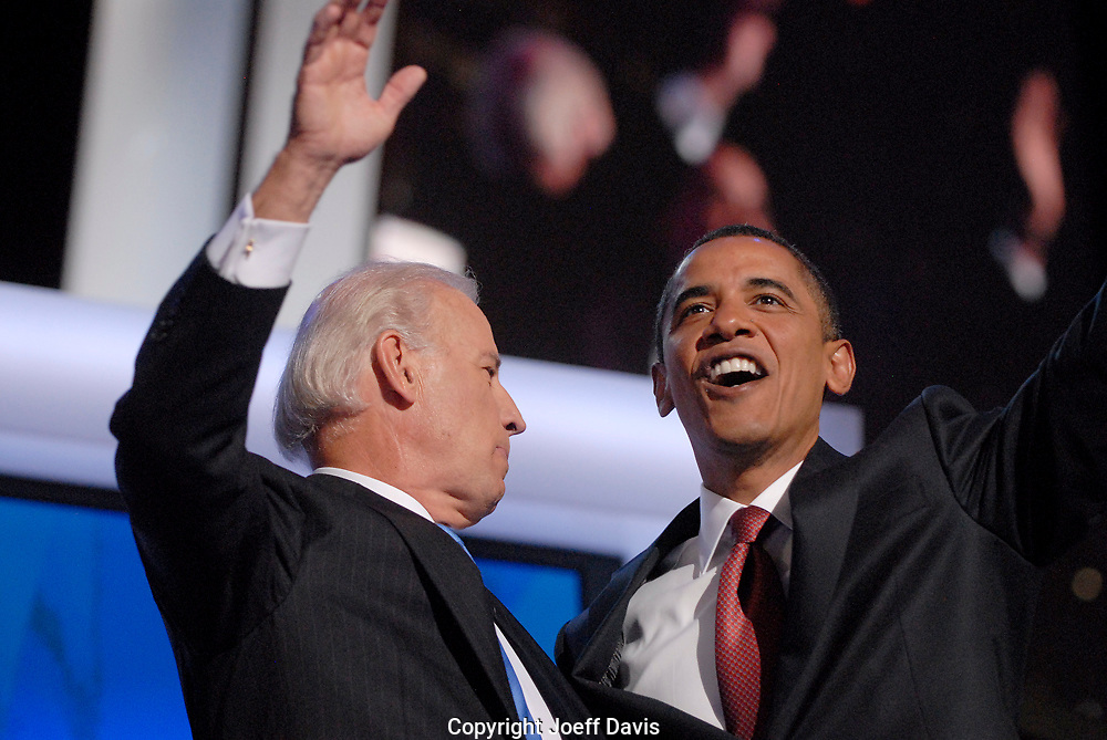 DENVER, CO - August 27, 2008: Democratic Presidential nominee Barack Obama with Vice Presidential nominee Joe Biden after making a surprise appearance, at the 2008 Democratic National Convention in Denver, Colorado, following Vice President nominee Joe Biden's speech. It is unusual for the nominee to make an appearance before their speech the final night of the convention.