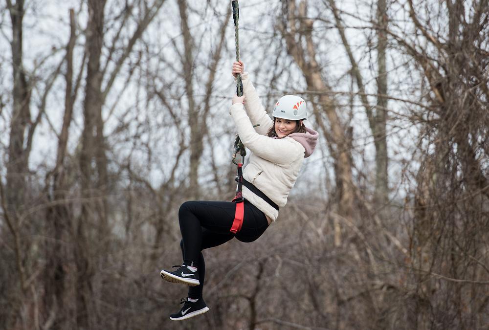 Olivia Grabill ziplines during the 'Zipline Adventure' oppurtunity held at the ridges during Sibs Weekend 2018.