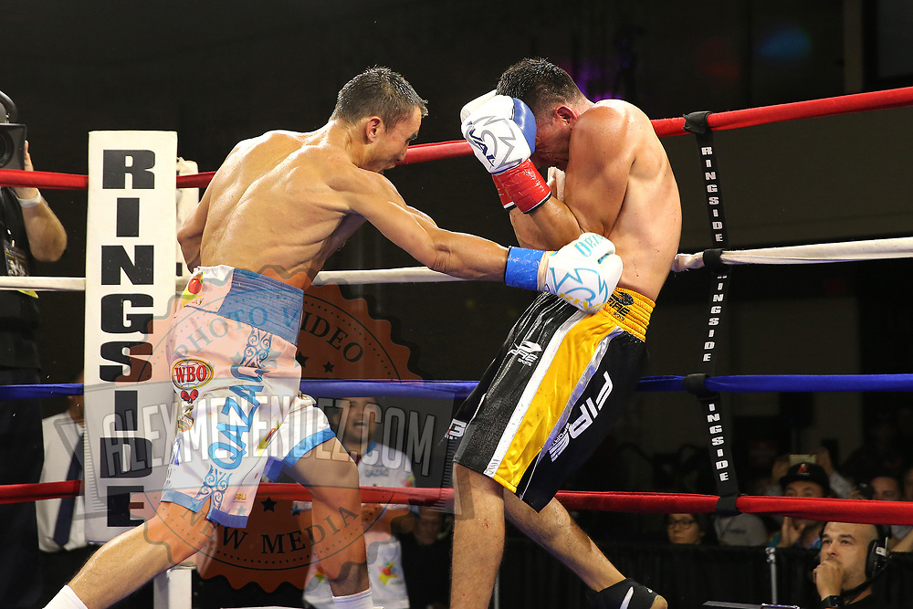"Kanat ""QazaQ"" Islam of Almaty, Kazakhstan (L) punches Noroberto ""Demonio"" Gonzalez of Monterrey, Mexico to win the NABO Jr. Middle Weight Title in a 12 round unanimous decision during a Nelsons Promotions boxing match at the Boca Raton Resort  and Club on Friday, May 26, 2017 in Boca Raton, Florida.  (Alex Menendez via AP)"