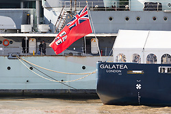 © Licensed to London News Pictures. 12/09/2017. LONDON, UK.  Two people walk past the London International Shipping Week flag on THV Galatea which has arrived in London and is moored next to HMS Belfast for London International Shipping Week. THV Galatea is a Trinity House multi-function ship, designed to carry out marine operations as part of their duty as the General Lighthouse Authority for England, Wales, the Channel Islands and Gibraltar. An estimated 15,000 shipping industry leaders are expected to attend events in London and on board the THV Galatea during International Shipping Week this week. Photo credit: Vickie Flores/LNP