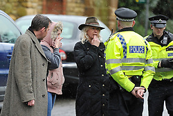 © Licensed to London News Pictures. Date 4 January 2014. Woodstock, Oxfordshire. Police talk to people at the scene. Body a woman (the householder) in her late 70's, has been found in a fire damaged house that has partially collapsed in Green Lane Woodstock. Photo credit : MarkHemsworth/LNP