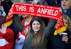 LIVERPOOL, ENGLAND - Sunday, March 8, 2015: A female Liverpool supporter with a 'This is Anfield' scarf before the FA Cup 6th Round Quarter-Final match against Blackburn Rovers at Anfield. (Pic by David Rawcliffe/Propaganda)