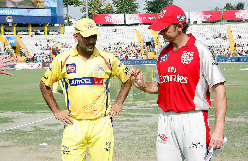 Kings XI Punjab captain Gill Christ (R) with Chennai Super Kings captain Mahender Singh Dhoni during the toss of match 9 of the Indian Premier League ( IPL ) Season 4 between the Kings XI Punjab and the Chennai Super Kings held at the PCA stadium in Mohali, Chandigarh, India on the 13th April 2011..Photo by Money Sharma/BCCI/SPORTZPICS