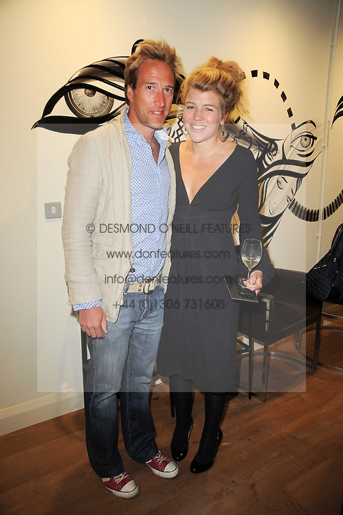 BEN FOGLE and AMBER AIKENS at a party to celebrate the publication of Born Wild by Tony Fitzjohn at The Arts Club, Dover Street, London on 16th September 2010.