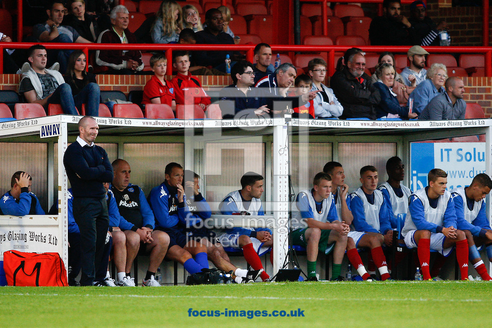 Picture by Andrew  Tobin/Focus Images Ltd +44 7710 761829.01/08/2012.. Portsmouth manager Michael Appleton (L) and the Portsmouth subs look on during the Friendly match at the EBB Stadium, Aldershot.