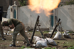 Licensed to London News Pictures. 02/04/2017. Mosul, Iraq. An Iraqi Emergency Response Division mortar team fire an 81mm mortar towards ISIS positions in a nearby part of West Mosul, Iraq today (02/04/2017).<br /> <br /> Iraqi forces continue to fight house to house as they push further into West Mosul. Iraqi forces are now advancing on the city's old districts where Islamic State fighters still hold out. Photo credit: Matt Cetti-Roberts/LNP