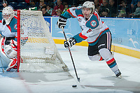KELOWNA, CANADA -FEBRUARY 19: \Colten Martin #8 of the Kelowna Rockets skates with the puck behing the net of Jordon Cooke during second period against the Tri City Americans on February 19, 2014 at Prospera Place in Kelowna, British Columbia, Canada.   (Photo by Marissa Baecker/Getty Images)  *** Local Caption *** Colten Martin; Cole Martin; Jordon Cooke;
