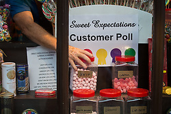 © Licensed to London News Pictures . 18/11/2014 . Kent , UK . UKIP sweet jar updated in the window of Sweet Expectations sweet shop on High Street , Rochester , ahead of the upcoming Rochester and Strood by-election . Jars representing the parties are filled with sweets corresponding to the voting intentions of the shop's customers . Photo credit : Joel Goodman/LNP