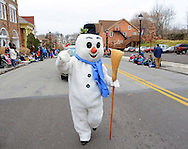 12/1/12 12:43:17 PM - Souderton, PA: .A snowman marches on Main Street during the Souderton/Telford Holiday Parade December 1, 2012 in Souderton, Pennsylvania -- (Photo by William Thomas Cain/Cain Images)