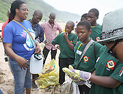 Terre des hommes Project Officer Sarah cossa speaks to the Wozobona Youth Group from Limpopo before they began the beach clean up organized by the Southern Durban Community Environmental Alliance (SCDEA)/KZN, 1 December 2011