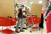 T.J. Abernathy weaves his cart, loaded with a ping pong table, through the checkout line at Target on Friday, Nov. 26, 2010, in Cape Girardeau. Target opened its doors to Black Friday shoppers at 4 a.m. Shortly after, the checkout line wound through the aisles all the way to the back of the store.