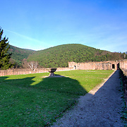 Late afternoon shadows claim the large projecting garden at Hardenburg castle ruin