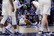Xavier guard KyKy Tandy (24) sits on the court awaiting medical attention after getting hit in the mouth during an NCAA college basketball game against Green Bay, Wednesday, Dec. 4, 2019, in Cincinnati. Xavier defeated Green Bay 84-71 (Jason Whitman/Image of Sport)