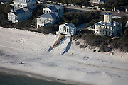 Erosion of barrier dunes threatens coastal homes.  A walkover has been built across the dune for beach access that will protect dune vegetation.