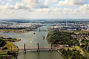 Nederland, Zuid-Holland, Gemeente Rotterdam, 15-07-2012; Spijkenisserbrug over het water van de Botlek (Oude Maas), tussen Spijkenisse en Hoogvliet (rechts). Botlekbrug en Shell Pernis in de achtergrond..Bridge over the water of the Botlek (Old Meuse), between Spijkenisse and Hoogvliet (right). Botlekbrug(bridge), Nieuwe Maas and Shell Pernis in the background. luchtfoto (toeslag), aerial photo (additional fee required).foto/photo Siebe Swart