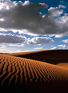 Sand dunes and clouds..For larger JPEGs and TIFF versions contact EFFECTIVE WORKING IMAGE via our contact page at : www.photography4business.com