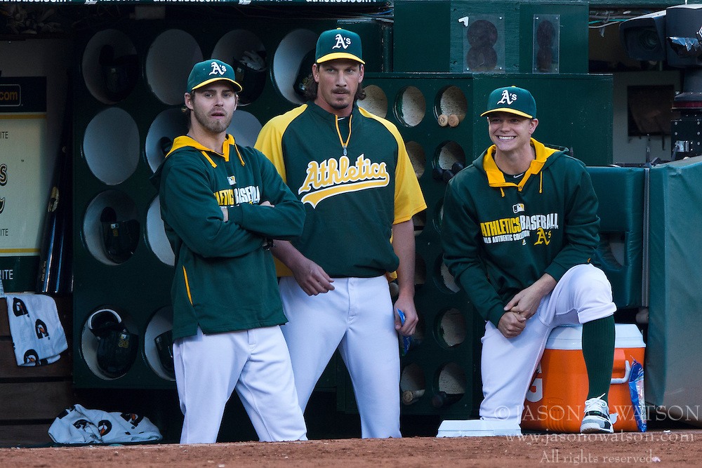OAKLAND, CA - JULY 05:  Jeff Samardzija #29 of the Oakland Athletics stands next to Sonny Gray #54 and Josh Reddick #16 in the dugout during the fourth inning against the Toronto Blue Jays at O.co Coliseum on July 5, 2014 in Oakland, California. (Photo by Jason O. Watson/Getty Images) *** Local Caption *** Jeff Samardzija; Sonny Gray; Josh Reddick