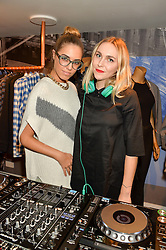 Left to right, AMBER LE BON and BECKY TONG at a party to celebrate 'Kitmas' at Kit & Ace at 80-82 Regent Street, London on 9th December 2015.