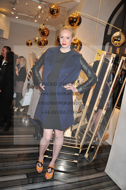 GWENDOLINE CHRISTIE at a party to celebrate the launch of a limited edition shoe The Chambord in celebration of Nicholas Kirkwood's partnership with Chambord black raspberry liqueur, held at the Nicholas Kirkwood Boutique, 5 Mount Street, London on 12th December 2012.