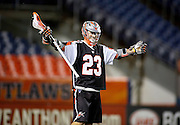 DENVER, CO - MAY 18: Drew Snider #23 of the Denver Outlaws celebrates after a goal against the Rochester Rattlers during their game at Sports Authority Field at Mile High May 18, 2013 in Denver, Colorado. The Denver Outlaws won the game 20-7. (Photo by Marc Piscotty/Getty Images) *** Local Caption *** Drew Snider