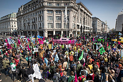 © Licensed to London News Pictures. 15/04/2019. London, UK. Extinction Rebellion members block Oxford Circus with a pink boat during a day of coordinated actions and demonstrations throughout London and other UK cities to highlight global climate change. Photo credit: Peter Macdiarmid/LNP
