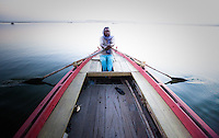 Man rows boat on the ganges river