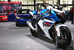 08 February 2012:  2012 GSX-R1000.Faster evolution is a hallmark of the GSX-R1000's engine. And 2012 brings another quick step ahead. Reaffirming the legendary motorcycle's claim to the top are improved throttle response, increased power and acceleration at mid-range engine speeds, and better fuel economy. Refinements ranging from a new stainless steel 4-2-1 exhaust system to completely redesigned pistons. The chassis, suspension and braking systems have also been refined for enhanced performance resulting in a reduction in weight of over four pounds...For 2012, the GSX-R1000 lets everyone know at a glance that it's the latest generation of the championship-winning supersport bikes that have dominated racetracks around the world. It features new colors and a variety of new styling elements, including new sporty instruments, new black fork tubes and new red pinstripes on the wheels. Put it all together and the GSX-R1000 offers incredible engine performance from idle to redline, smoother suspension performance, even more responsive handling and superior braking performance — exactly what you need to Own The Racetrack. Chicago Auto Show, Chicago Automobile Trade Association (CATA), McCormick Place, Chicago Illinois
