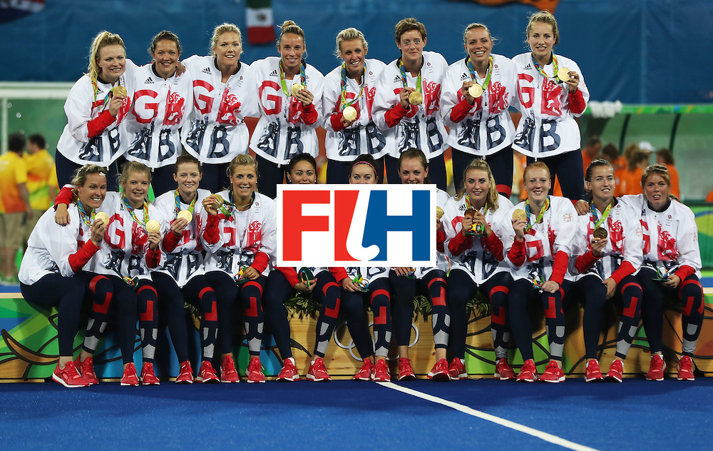 RIO DE JANEIRO, BRAZIL - AUGUST 19:  Great Britain celebrates on the podium after winning a penalty shoot out during the Women's Hockey final between Great Britain and the Netherlands on day 14 at Olympic Hockey Centre on August 19, 2016 in Rio de Janeiro, Brazil. (Photo by Ian MacNicol/Getty Images)