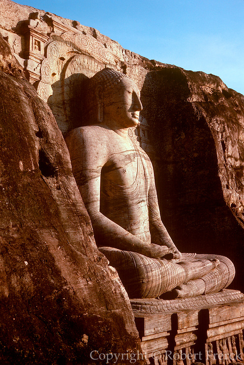 SRI LANKA, BUDDHISM The Gal Vihara Buddha, seated figure 23 feet  tall, cut from solid rock, carved in the  12th.C at Polonnaruwa