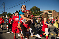Freshman DC Heroes begin their march down Union Avenue during LHS Homecoming parade Friday afternoon.  (Karen Bobotas/for the Laconia Daily Sun)