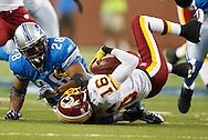Detroit Lions running back Maurice Morris (28)  tackles Washington Redskins wide receiver Brandon Banks (16) in the NFL football game at Ford Field in Detroit, Sunday, Oct. 31, 2010. (AP Photo/Rick Osentoski)