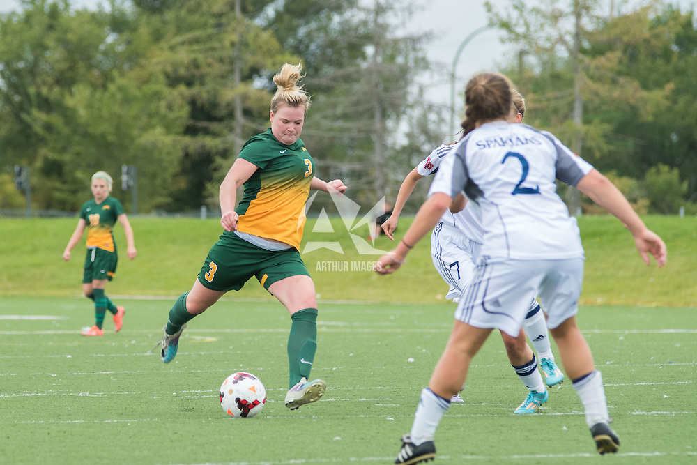 5th year defender Kayla McDonald (3) of the Regina Cougars takes a shot on goal during the Women's Soccer home game on September 11 at U of R Field. Credit: Arthur Ward/Arthur Images