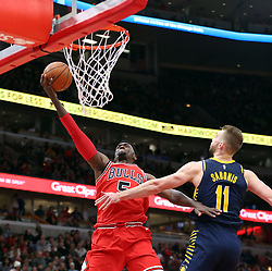 December 29, 2017 - Chicago, IL, USA - The Chicago Bulls' Bobby Portis (5) attacks the basket as the Indiana Pacers' Domantas Sabonis (11) defends in the first half at the United Center in Chicago on Friday, Dec. 29, 2017. The Bulls won, 119-107. (Credit Image: © Terrence Antonio James/TNS via ZUMA Wire)