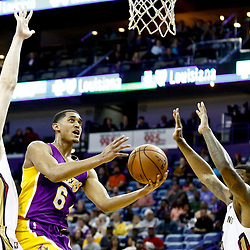 Nov 29, 2016; New Orleans, LA, USA; Los Angeles Lakers guard Jordan Clarkson (6) shoots over New Orleans Pelicans center Omer Asik (3) and forward Terrence Jones (9) during the first quarter of a game at the Smoothie King Center. Mandatory Credit: Derick E. Hingle-USA TODAY Sports