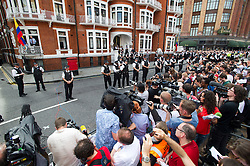 © Licensed to London News Pictures. 19/08/2012. Crowds of Media, Assange supporters and members of the public watch Wikileaks founder Julian Assange speaking from a balcony at The Ecuador Embassy in London on August 19/08/2012. Assange, who faces arrest by British police if he leaves the building, took refuge in the embassy on June 19 to evade extradition to Sweden where he is wanted for questioning over alleged sexual misconduct. Photo credit : Ben Cawthra/LNP