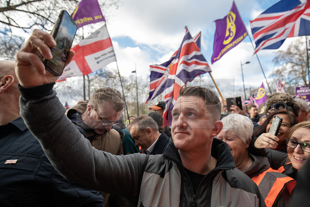 © Licensed to London News Pictures. 09/12/2018. London, UK. Political activist Stephen Yaxley-Lennon, also known as Tommy Robinson takes part in a 'Brexit Betrayal' march in central London, campaigning against Theresa May's Brexit deal. A counter demonstration organised by Unite Against Fascism and Racism is also taking place on a different route.  Photo credit : Tom Nicholson/LNP