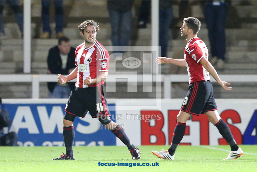 Jose Baxter (l) of Sheffield United celebrates scoring the opening goal during the Johnstone's Paint Trophy match at Victoria Park, Hartlepool<br /> Picture by Simon Moore/Focus Images Ltd 07807 671782<br /> 07/10/2014